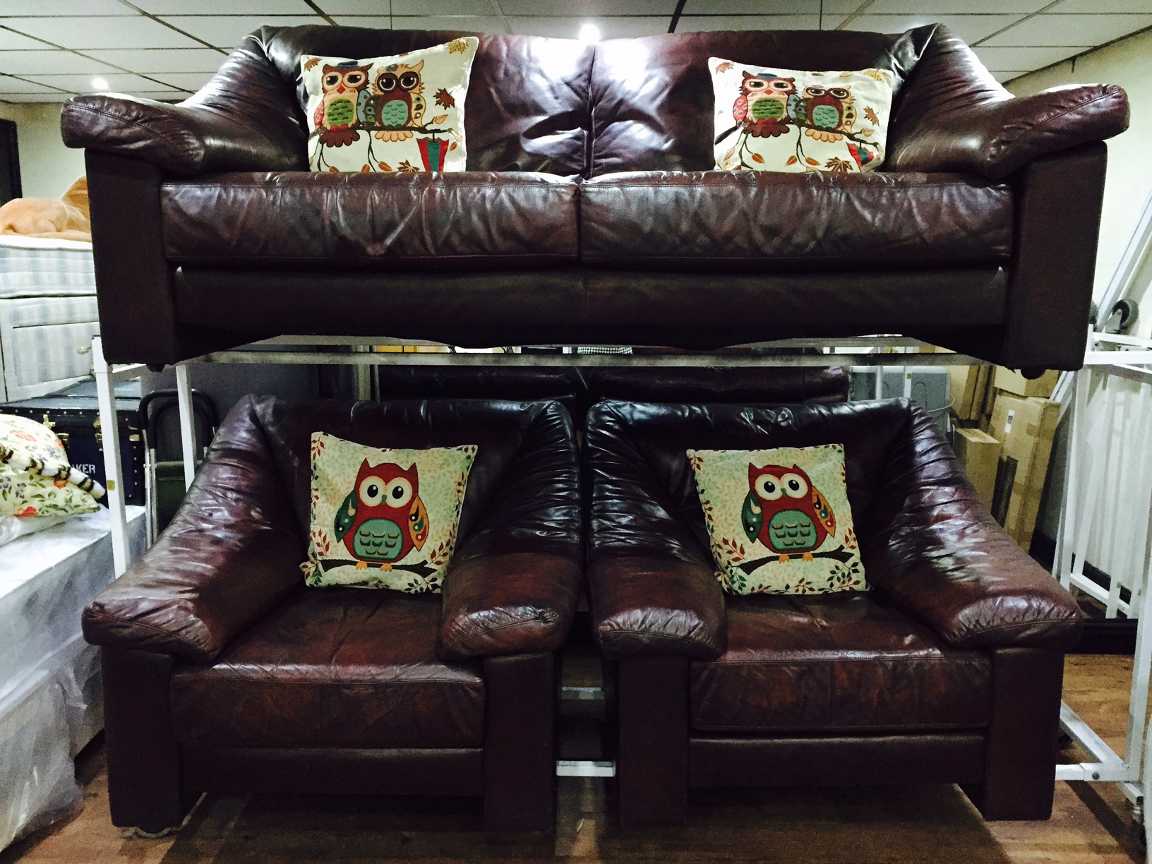 Quality leather three seater and two armchairs